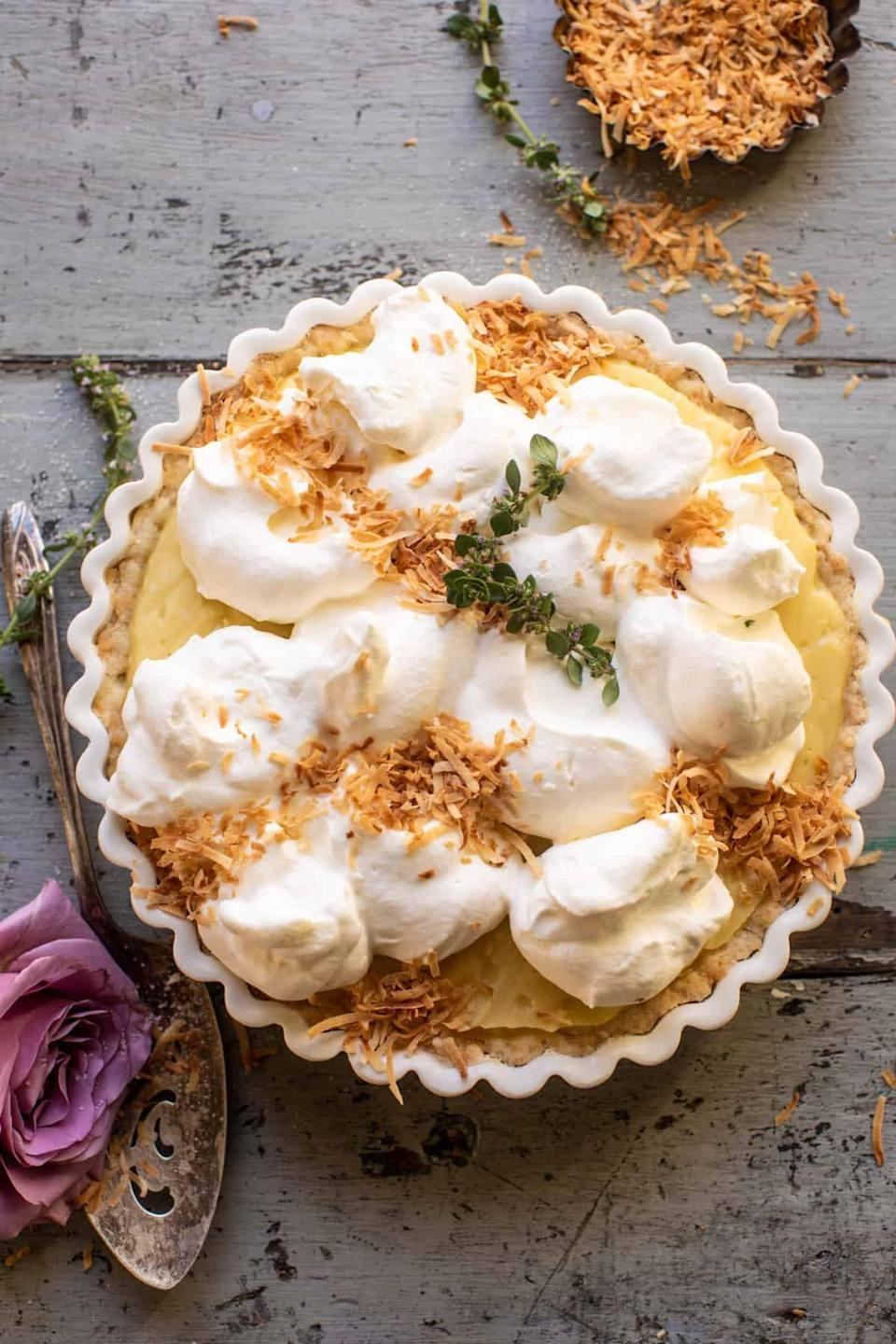 "<p>There's something special about a homemade coconut-cream pie, especially when it's made with a tangy lemon twist. This recipe is comprised of a sweet coconut crust that's layered with vanilla coconut pudding and topped with coconut-flaked whipped cream and a light dusting of lemon sugar. Yes, please.</p> <p><strong>Get the recipe</strong>: <a href=""https://www.halfbakedharvest.com/lemon-sugar-coconut-cream-pie/"" class=""link rapid-noclick-resp"" rel=""nofollow noopener"" target=""_blank"" data-ylk=""slk:lemon sugar coconut-cream pie"">lemon sugar coconut-cream pie</a></p>"