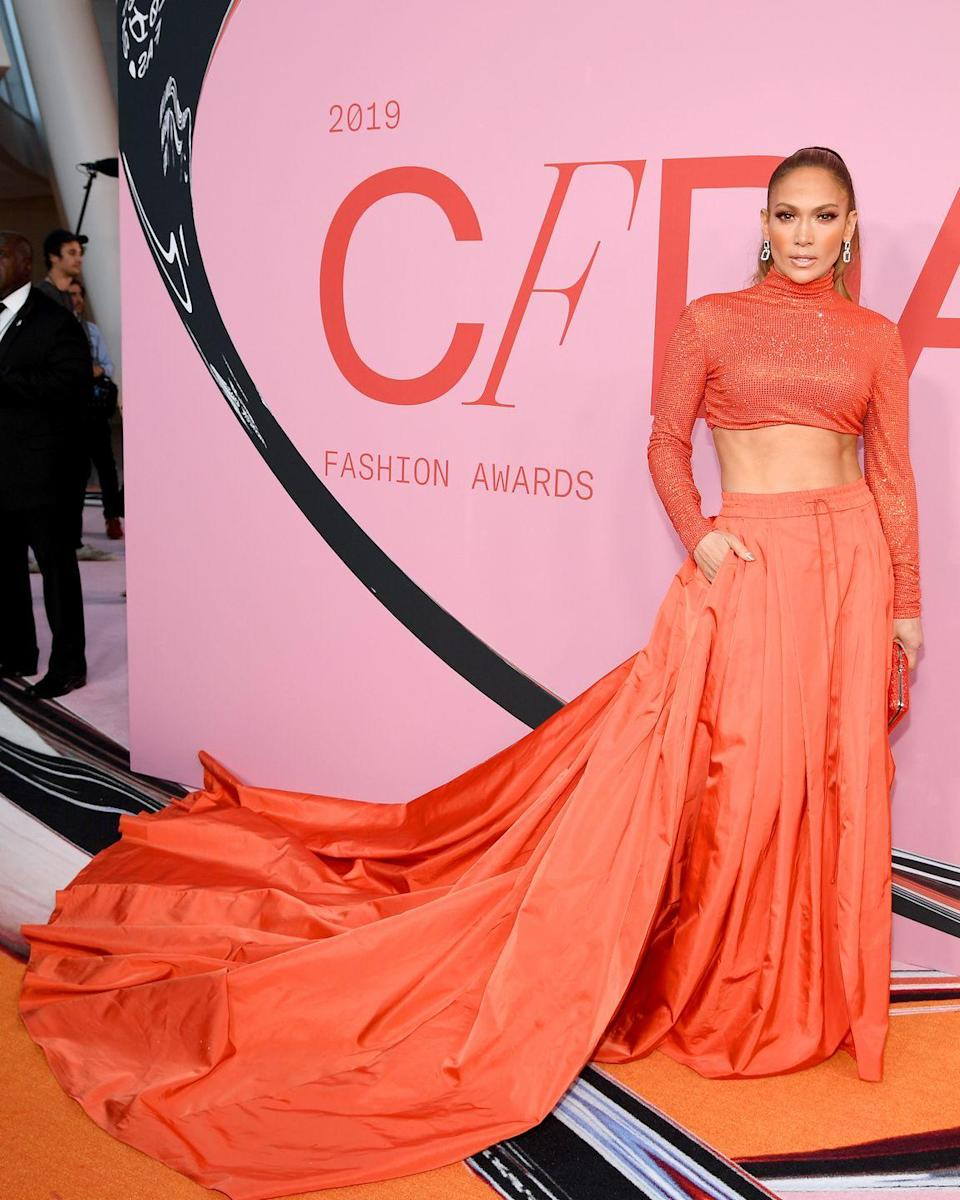 <p>To pick up the Fashion Icon award at this year's ceremony, J.Lo wore an orange co-ord by Ralph Lauren.</p>