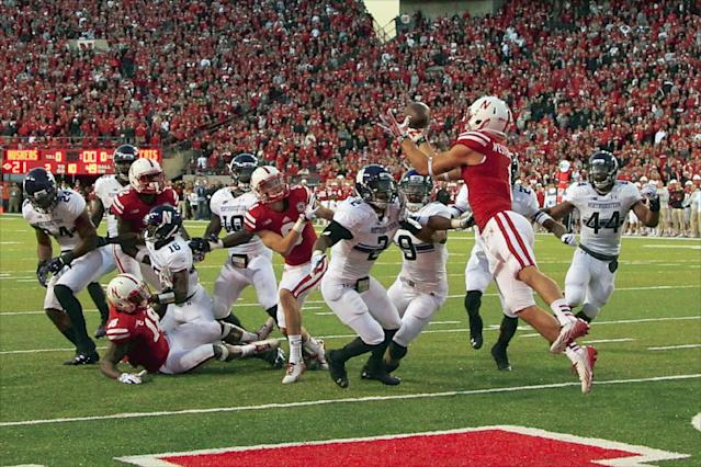 Nebraska wide receiver Jordan Westerkamp (1) catches the game winning touchdown over Northwestern center back Dwight White (2) , safety Jimmy Hall (9) and linebacker Chi Chi Ariguzo (44) with seconds to go in the second half of an NCAA college football game against Northwestern in Lincoln, Neb., Saturday, Nov. 2, 2013. Nebraska won 27-24. (AP Photo/Nati Harnik)