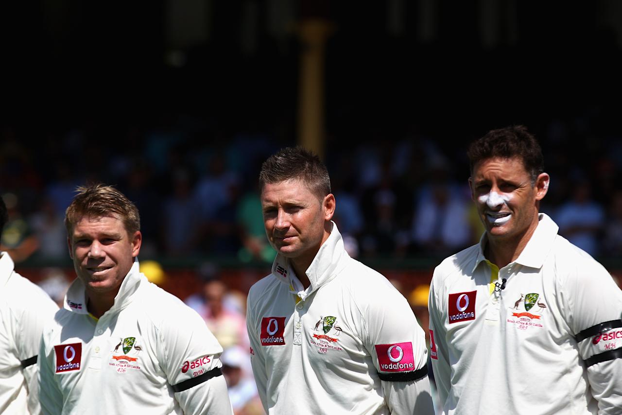 SYDNEY, AUSTRALIA - JANUARY 03: David Warner, Michael Clarke and Michael Hussey of Australia stand to honour Tony Grieg who passed away last week during day one of the Third Test match between Australia and Sri Lanka at Sydney Cricket Ground on January 3, 2013 in Sydney, Australia.  (Photo by Ryan Pierse/Getty Images)