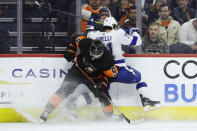 Philadelphia Flyers' Ivan Provorov, left, and Tampa Bay Lightning's Anthony Cirelli collide during the third period of an NHL hockey game, Saturday, Jan. 11, 2020, in Philadelphia. (AP Photo/Matt Slocum)