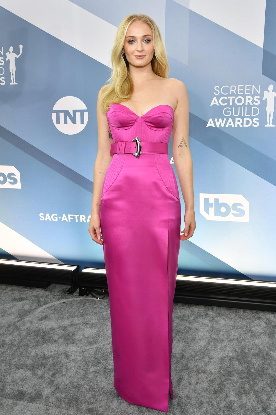 """<p>Sophie wore a custom, Barbie pink bustier <a href=""""https://www.popsugar.com/fashion/sophie-turner-hot-pink-dress-at-sag-awards-2020-47124428"""" class=""""link rapid-noclick-resp"""" rel=""""nofollow noopener"""" target=""""_blank"""" data-ylk=""""slk:gown to the 2020 SAG Awards"""">gown to the 2020 SAG Awards</a> with <a class=""""link rapid-noclick-resp"""" href=""""https://www.popsugar.com/Joe-Jonas"""" rel=""""nofollow noopener"""" target=""""_blank"""" data-ylk=""""slk:Joe Jonas"""">Joe Jonas</a>, accessorizing with LV High Jewelry and metallic sandals.</p>"""