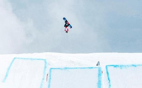 Aimee Fuller flying high in Laax - Credit: Aivars Zarins MOTIONSTOPPERS.COM