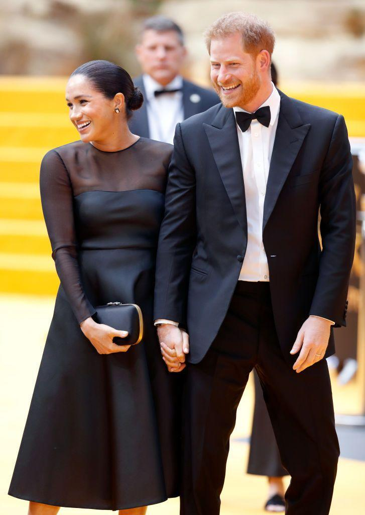 <p>The Duke and Duchess of Sussex laugh as they walk the red carpet of <em>The Lion King</em> premiere in London. </p>