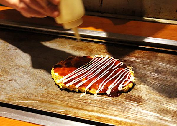 The appeal of seeing food on the griddle in real time