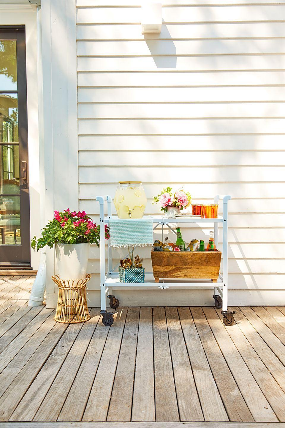 <p>Turn a traditional utility cart into a fun drink station with glassware, utensils, and a pitcher full of your favorite warm-weather beverage. <br></p>