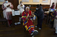 A clown gets a shot of the Sinopharm COVID-19 vaccine during a vaccination campaign targeting people between ages 18 and 30 at the public University San Andres in La Paz, Bolivia, Monday, July 5, 2021. (AP Photo/Juan Karita)