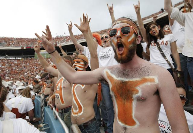 Texas fans cheer during the first half of an NCAA college football game against the Oklahoma at the Cotton Bowl Saturday, Oct. 12, 2013, in Dallas. (AP Photo/Brandon Wade)