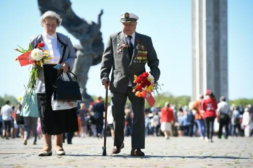 Members of Latvia's Russian minority gather at the Victory Monument to mark 73 years since the end of World War II