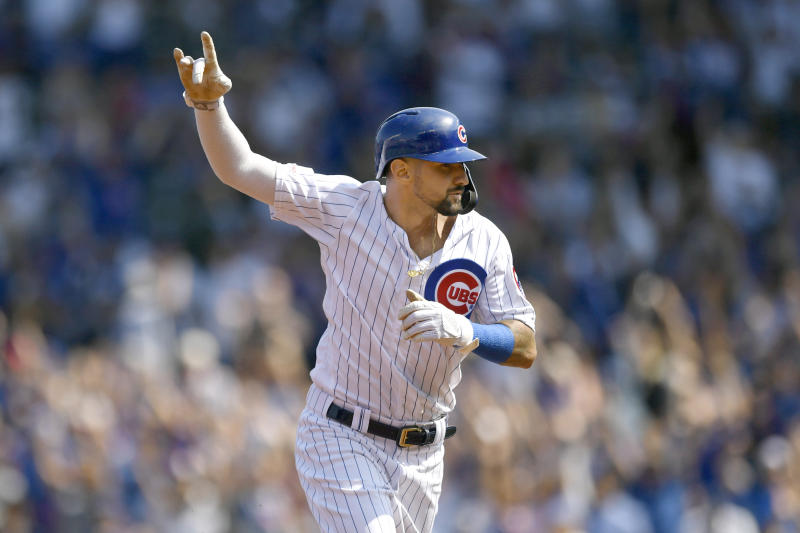 Chicago Cubs' Nicholas Castellanos celebrates while rounding the bases after Kris Bryant hit a three-run home run during the first inning of a baseball game against the Pittsburgh Pirates Sunday, Sept. 15, 2019, in Chicago. (AP Photo/Paul Beaty)