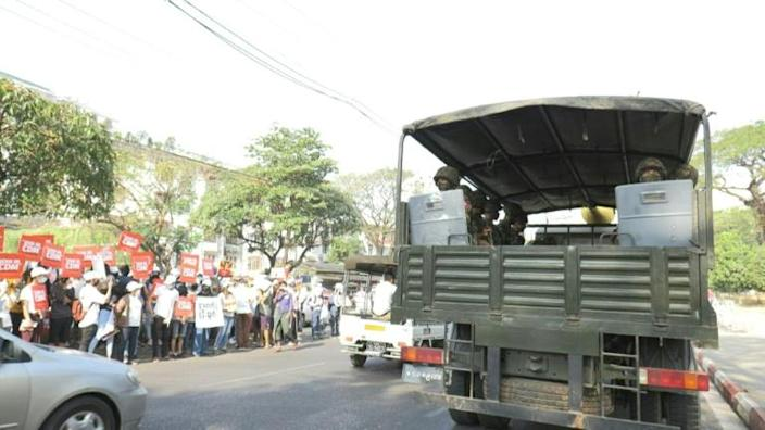 Soldiers and protesters face off outside Myanmar Central Bank