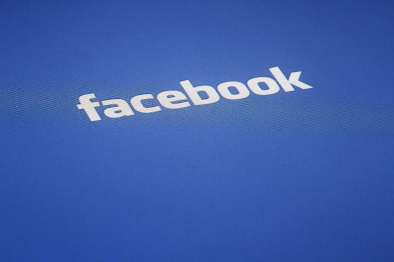 A Facebook logo is displayed on the screen of an iPad, Wednesday, May 16, 2012 in New York. Facebook's initial public offering is one of the most hotly anticipated in years. The company is likely to have an estimated market valuation of $100 billion when its shares begin trading on the Nasdaq stock market on Friday. (AP Photo/James H. Collins)
