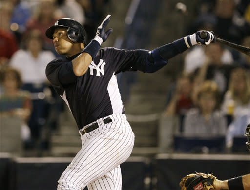 New York Yankees third baseman Alex Rodriguez follows through on a third-inning, RBI single that allowed Curtis Granderson to score during their spring training baseball game against the Pittsburgh Pirates at Steinbrenner Field in Tampa, Fla., Tuesday, March 20, 2012. (AP Photo/Kathy Willens)