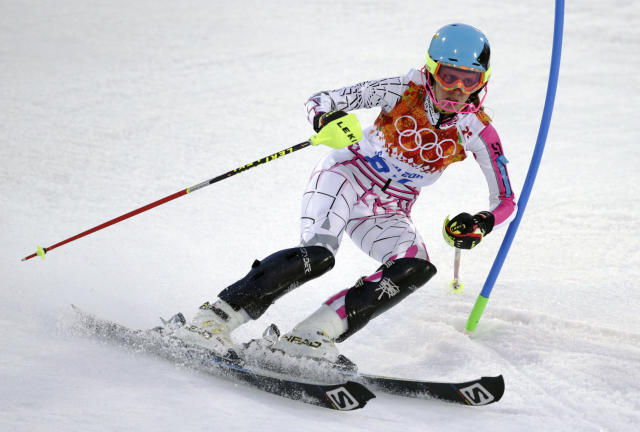 Lebanon's Jacky Chamoun skis past a gate in the first run of the women's slalom at the Sochi 2014 Winter Olympics, Friday, Feb. 21, 2014, in Krasnaya Polyana, Russia. (AP Photo/Charles Krupa)