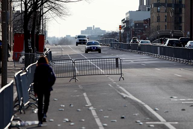 BOSTON, MA - APRIL 15: Emergency vehicles make their way down an empty Beacon Street near Kenmore Square after two explosive devices detonated at the finish line of the 117th Boston Marathon on April 15, 2013 in Boston, Massachusetts. Two people are confirmed dead and at least 23 injured after two explosions went off near the finish line to the marathon. (Photo by Alex Trautwig/Getty Images)