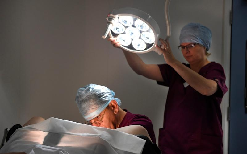Dr Amin Gorgy, carries out an examination at the Fertility and Gynaecological Centre in London - Credit: Julian Simmonds