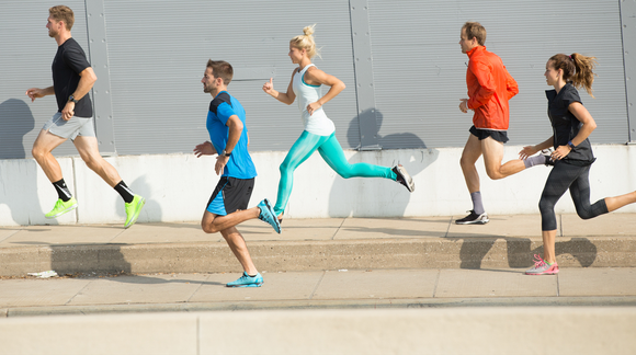Runners in Under Armour apparel.