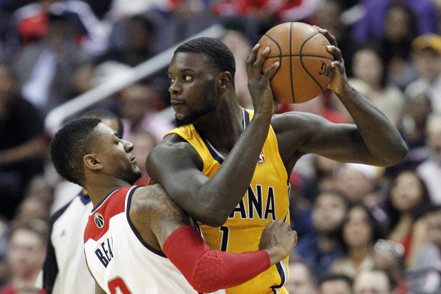 Indiana Pacers guard Lance Stephenson (1) looks for a way around Washington Wizards guard Bradley Beal during the first half of Game 3 of an Eastern Conference semifinal NBA basketball playoff game in Washington, Friday, May 9, 2014. (AP Photo/Alex Brandon)