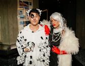 <p>Mia Swier and Darren Criss went with a Disney classic for a 2019 Halloween party—ultimate baddie Cruella De Vil and one of her many Dalmatian pups (plus several more even smaller pups)!</p>