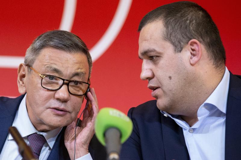 FILE - In this Saturday, Nov. 3, 2018 file photo, the new president of the amateur boxing federation Gafur Rakhimov, left, and Secretary General of the Boxing Federation of Russia Umar Kremlyov talk to each other during a news conference following the AIBA congress in Moscow, Russia. The embattled amateur boxing federation faces an Olympic inquiry on Monday May 20, 2019 fearing it could be punished for forcing out a longtime IOC member as its president. (AP Photo/Alexander Zemlianichenko, File)