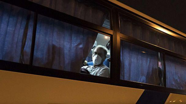 PHOTO: American citizens arrive by bus from the quarantined Diamond Princess cruise ship to Haneda airport on Feb. 17, 2020 in Tokyo to be repatriated to the U.S (Tomohiro Ohsumi/Getty Images)