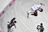 <p>Sweden's Oskar Rozenberg competes in the men's park heats during the Tokyo 2020 Olympic Games at Ariake Sports Park Skateboarding in Tokyo on August 05, 2021. (Photo by Loic VENANCE / AFP)</p>