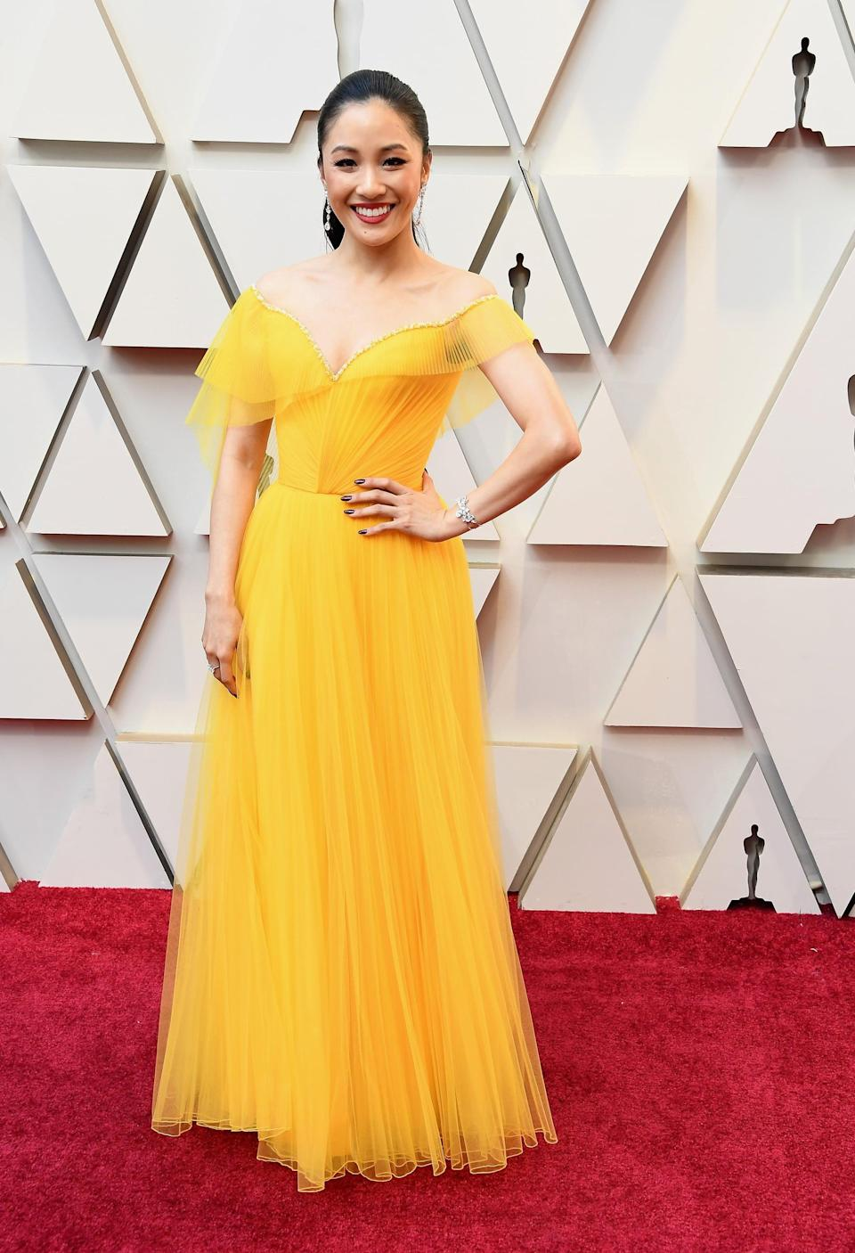 <p>Wearing an Atelier Versace dress with jewels by Neil J. Rodgers and Swarovski.</p>