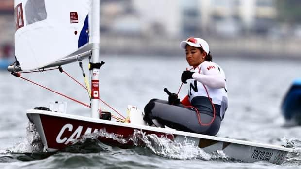 Canada's Sarah Douglas is shown above during qualifying for the laser radial final at the Tokyo Olympics. (Carlos Barria/Reuters - image credit)