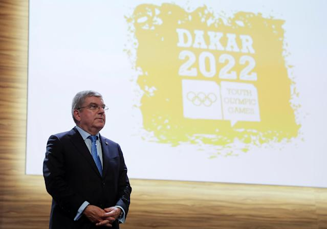 Thomas Bach, President of the International Olympic Committee (IOC), stands next to a Dakar 2022 Youth Olympic Games logo after signing the contract for the 2022 candidacy with Senegal at the 133rd IOC session in Buenos Aires, Argentina October 8, 2018. Natacha Pisarenko/Pool via REUTERS