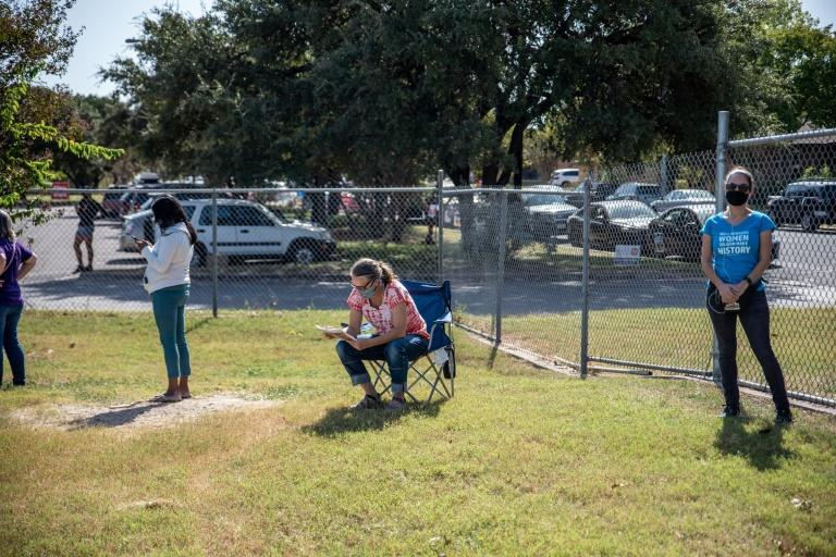 Voters wait in line at a polling location on October 13, 2020 in Austin, Texas