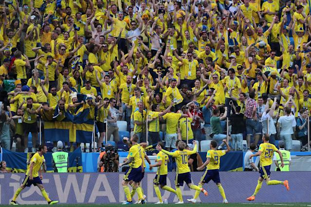Soccer Football - World Cup - Group F - Sweden vs South Korea - Nizhny Novgorod Stadium, Nizhny Novgorod, Russia - June 18, 2018 Sweden's Andreas Granqvist celebrates scoring their first goal in front of fans with team mates REUTERS/Ivan Alvarado