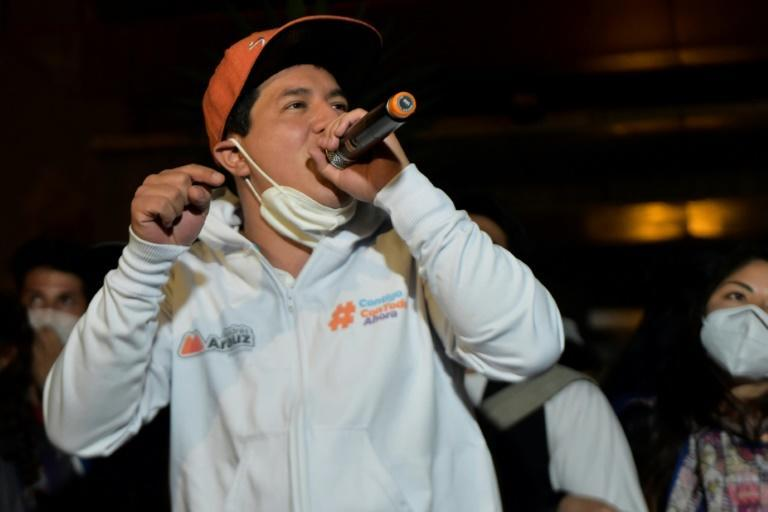 Andres Arauz, who plans to switch to clean energy instead of fossil fuels for generating electricity and for the public transport system, speaks during a campaign rally with rappers in Quito on April 1, 2021