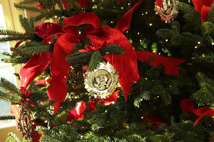 <p>Ornaments on a Christmas tree at the White House during a press preview of the 2017 holiday decorations Nov. 27, 2017 in Washington, D.C. (Photo: Alex Wong/Getty Images) </p>