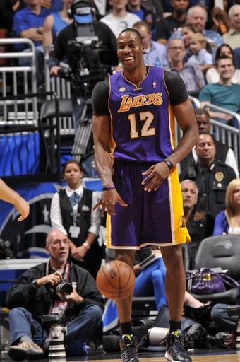 ORLANDO, FL - MARCH 12: Dwight Howard #12 of the Los Angeles Lakers smiles while dribbling the ball against the Orlando Magic during the game on March 12, 2013 at Amway Center in Orlando, Florida. (Photo by Fernando Medina/NBAE via Getty Images)