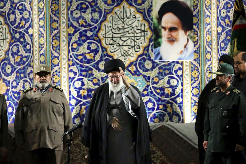 "In this photo released by an official website of the Iranian supreme leader's office on Wednesday, Nov. 20, 2013, Iran's Supreme Leader Ayatollah Ali Khamenei waves to members of the paramilitary Basij force at the Imam Khomeini Grand Mosque in Tehran, Iran. Khamenei says pressure from economic sanctions will never force the country into unwelcome concessions as nuclear negotiators resumed talks with world powers. Khamenei also blasted U.S. government policies, including threats of military action, but said Iran has ""no animosity'"" toward the American people and seeks ""friendly"" relations. (AP Photo/Office of the Supreme Leader)"
