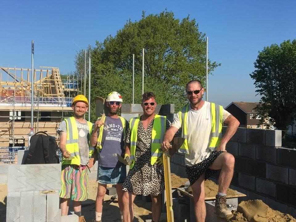 """Construction workers opt for a breezy look including dresses and skirts. Their dress code says """"no shorts"""" but doesn't prevent them from wearing dresses. (Photo: Chad Cusselle via Facebook)"""