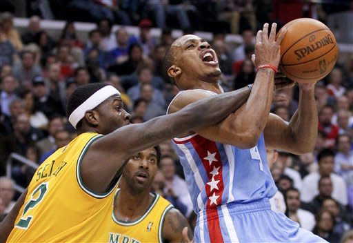 Memphis Grizzlies guard Josh Selby, left, fouls Los Angeles Clippers guard Randy Foye during the first half of an NBA basketball game in Los Angeles, Thursday, Jan. 26, 2012. (AP Photo/Chris Carlson)