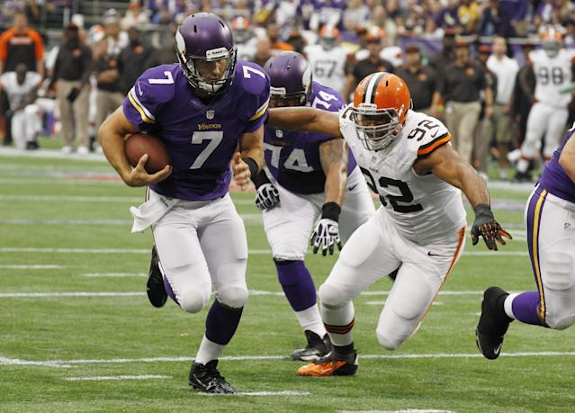 Minnesota Vikings quarterback Christian Ponder, left, runs from Cleveland Browns defensive end Desmond Bryant while scoring on a 6-yard touchdown run in the first half of an NFL football game Sunday, Sept. 22, 2013, in Minneapolis. (AP Photo/Ann Heisenfelt)