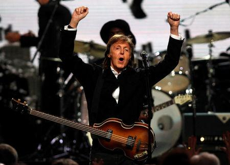 FILE PHOTO - Paul McCartney celebrates after performing with Starr during the 2015 Rock and Roll Hall of Fame Induction Ceremony in Cleveland