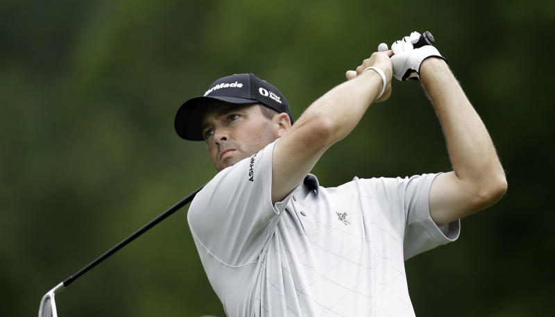 Ryan Palmer watches his tee shot on the fourth hole during the first round of the Colonial golf tournament, Thursday, May 23, 2013, in Forth Worth, Texas.  (AP Photo/LM Otero)