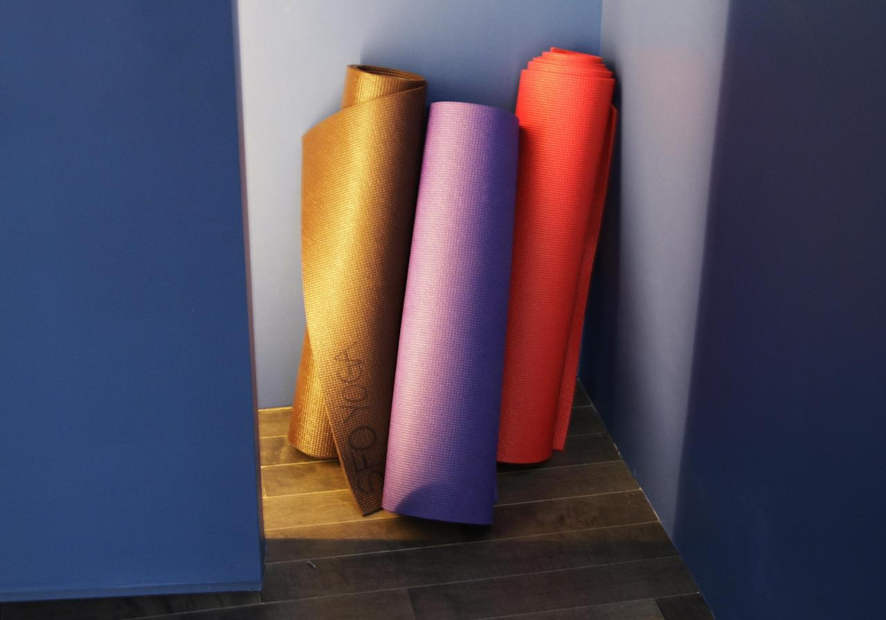 In this Friday, Jan. 27, 2012 photo, yoga mats lean against a wall at San Francisco International Airport's new Yoga Room, in San Francisco. The quiet, dimly lit studio officially opened last week in a former storage room just past the security checkpoint at SFO's Terminal 2. Airport officials believe the 150-square-foot room with mirrored walls is the world's first airport yoga studio, said spokesman Mike McCarron. (AP Photo/Paul Sakuma)