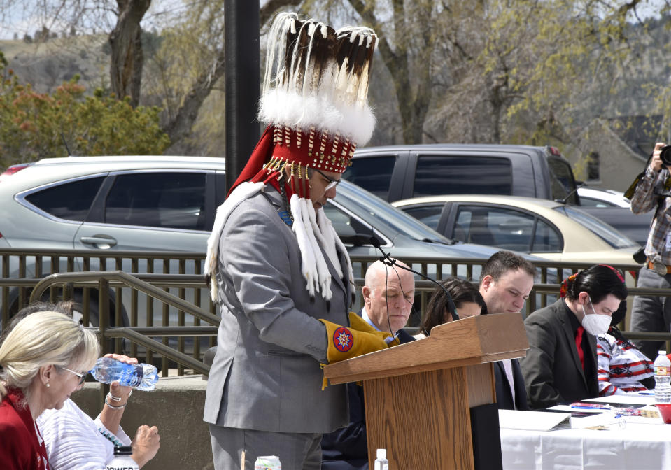 Marvin Weatherwax, state House member and business council member of the Blackfeet tribe, addresses a crowd gathered to honor missing and murdered indigenous people in front of the Montana state Capitol in Helena, Mont., Wednesday, May 5, 2021. From Washington to Indigenous communities across the American Southwest, top government officials, family members and advocates gathered Wednesday as part of a call to action to address the ongoing problem of violence against Indigenous women and children. (AP Photo/Iris Samuels)