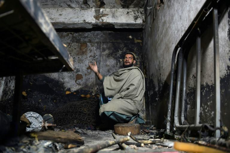 Mohammad Umair returns to his apartment in Karachi where a fire that started in garbage outside the building killed his three children