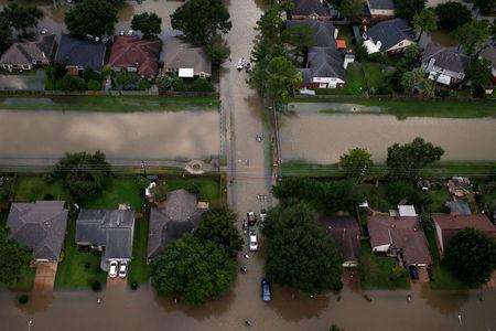 FILE PHOTO: Houses are seen partially submerged in flood waters caused by Tropical Storm Harvey in Northwest Houston Texas