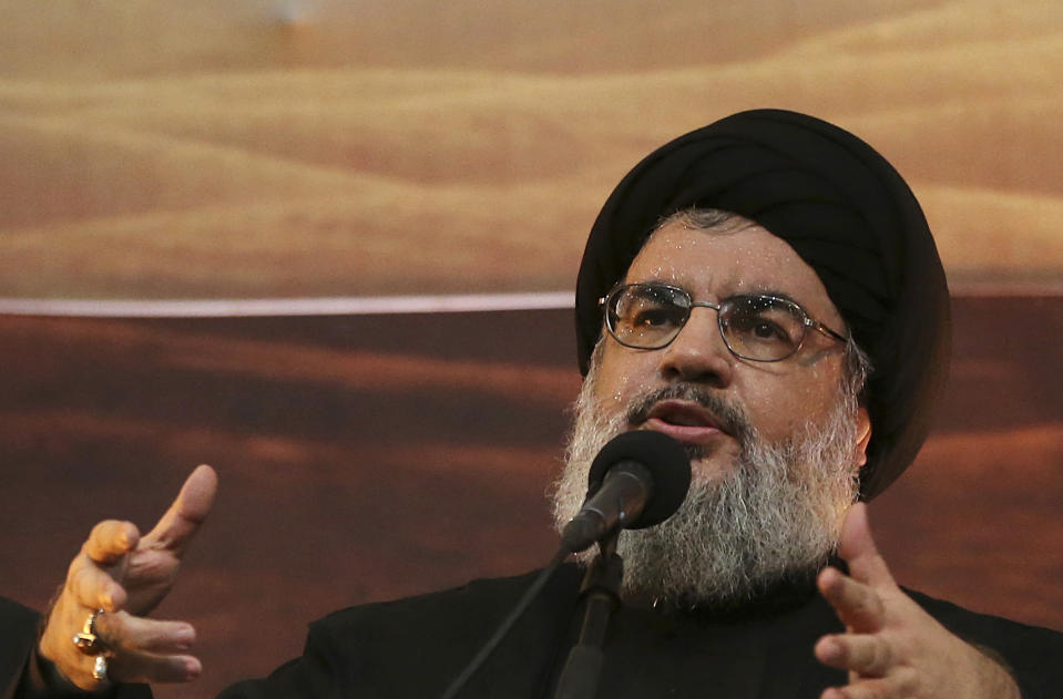 FILE -In this Nov. 3, 2014 file photo, Hezbollah leader Sheik Hassan Nasrallah addresses supporters ahead of the Shiite Ashura commemorations, in the southern suburb of Beirut, Lebanon. On Saturday, Jan. 26, 2019, the head of Lebanon's Hezbollah group is warning Israel of widening its attacks in Syria because a miscalculation can drag the region into a war. (AP Photo/Hussein Malla, File)