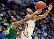 <p>Trent Forrest #3 of the Florida State Seminoles is fouled by Ben Shungu #24 of the Vermont Catamounts during their first round game of the 2019 NCAA Men's Basketball Tournament at XL Center on March 21, 2019 in Hartford, Connecticut. (Photo by Rob Carr/Getty Images) </p>