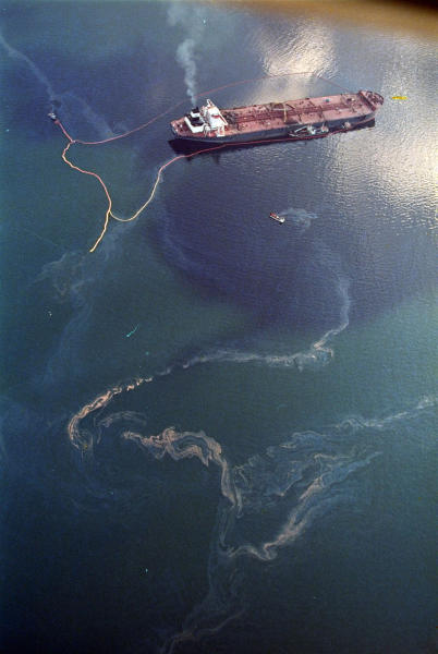 FILE - In this April 9, 1989 file photo, crude oil from the tanker Exxon Valdez, top, swirls on the surface of Alaska's Prince William Sound near Naked Island.  Indian company Best Oasis that dismantles old ships has bought the notorious Exxon Valdez, the tanker involved in one of the worst oil spills in U.S. history, a company official said Friday, March 23, 2012. (AP Photo/John Gaps III, File)