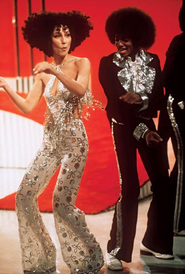 "<b>1974:</b> Cher boogied with the ""adorable"" Michael Jackson and his brothers on her variety show. The hair was ""an Afro but in a Cher way""; the beaded halter and floral bell-bottoms were pure Mackie. ""We spent hours on fittings,"" she says. ""Bob told me if I got any thinner he would stop making clothes for me.""   <a href=""http://www.instyle.com/instyle/package/transformations/photos/0,,20290121_20331288_20719623,00.html?xid=omg-cher-gaga-trans?yahoo=yes"" target=""new"">Check Out Lady Gaga's Style Transformation</a> Steve Schapiro/Corbis - 1974"