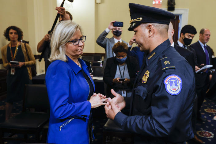 FILE - In this July 27, 2021 file photo, Rep. Liz Cheney, R-Wyo., speaks with U.S. Capitol Police Sgt. Aquilino Gonell after a House select committee hearing on the Jan. 6 attack on Capitol Hill in Washington. House Democrats have promoted Republican Rep. Liz Cheney to vice chairwoman of a committee investigating the Jan. 6 Capitol insurrection. They're placing Cheney in a leadership spot on the panel as some members of the GOP caucus are threatening to oust her for participating. Cheney is a fierce critic of former President Donald Trump and has remained defiant amid the criticism from her own party. (Jim Bourg/Pool via AP)