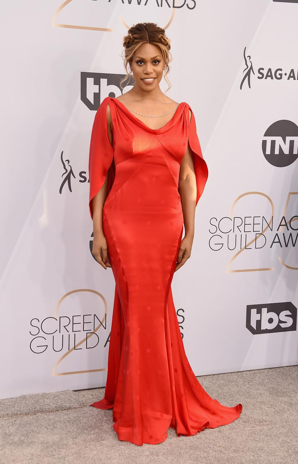 <p>Laverne Cox opted for a flattering red gown at the 2019 Screen Actors Guild Awards. (Photo: Getty Images) </p>
